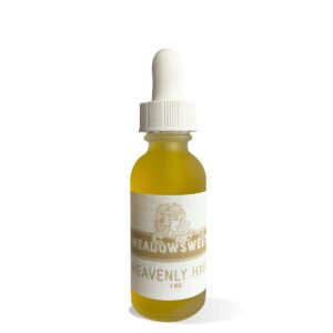 Frosted glass dropper bottle containing Heavenly Hair Oil.