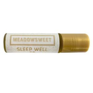 Small glass cylinder with gold lid and white label containing Sleep Well Balm.