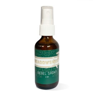 a tall brown bottle with a white spray top contains a essential oil and carrier mix
