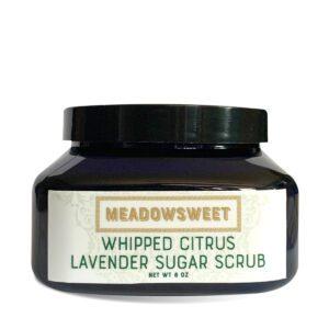 A closed blue plastic tub of Whipped Citrus/Lavender Sugar Scrub