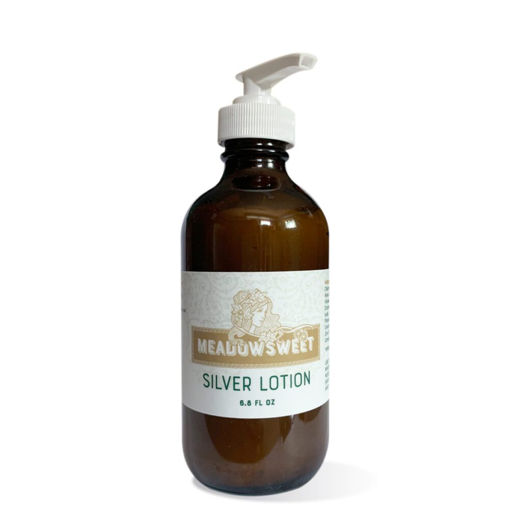 A large brown bottle with a white lotion pump contains Soothing Silver Lotion